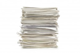 Large stack of papers on a white background