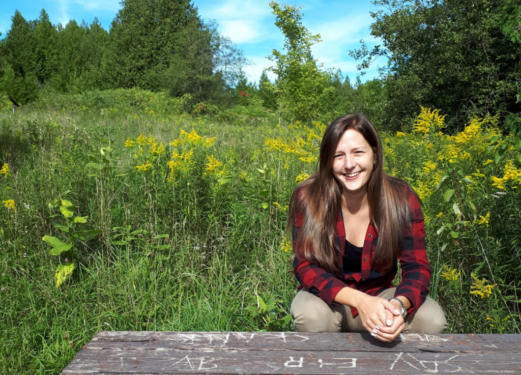 Alyssa Jeffrey in a green meadow at Windy Ridge Conservation Area, Omemee, Ontario